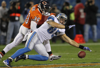 CHICAGO, IL - NOVEMBER 13: Tony Scheffler #85 of the Detroit Lions drops a pass under pressure from D.J. Moore #30 of the Chicago Bears at Soldier Field on November 13, 2011 in Chicago, Illinois. The Bears defeated the Lions 37-13. (Photo by Jonathan Dani