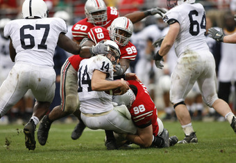 Jay Richardson of Ohio State turns Anthony Morelli's helmet on a tackle during action between Penn State and Ohio State in Columbus, Ohio on September 23, 2006.  Ohio State won 28-6. (Photo by G. N. Lowrance/Getty Images)