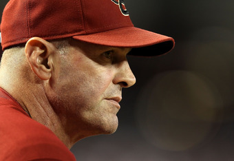 PHOENIX, AZ - SEPTEMBER 28:  Manager Kirk Gibson of the Arizona Diamondbacks watches from the dugout during the Major League Baseball game against the Los Angeles Dodgers at Chase Field on September 28, 2011 in Phoenix, Arizona.  The Dodgers defeated the