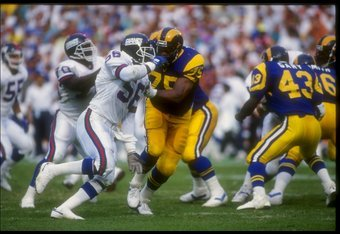 11 Nov 1990:  Linebacker Lawrence Taylor of the New York Giants (center) works against the Los Angeles Rams during a game at Anaheim Stadium in Anaheim, California.  The Giants won the game, 31-7. Mandatory Credit: Stephen Dunn  /Allsport