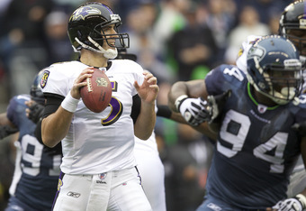 SEATTLE, WA - NOVEMBER 13: Quarterback Joe Flacco #5 of the Baltimore Ravens looks to pass during play against the Seattle Seahawks at CenturyLink Field on November 13, 2011 in Seattle, Washington. The Seahawks won 22-17.  (Photo by Stephen Brashear /Gett