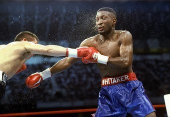 Pernell Whitaker gets hit here by Julio Cesar Chavez, one of the rare times Chavez landed all night in their highly-disputed draw.