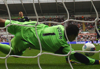 SWANSEA, WALES - AUGUST 20:  Michael Vorm of Swansea City saves the penalty kick from Ben Watson of Wigan during the Barclays Premier League match between Swansea City and Wigan Athletic at Liberty Stadium on August 20, 2011 in Swansea, Wales.  (Photo by