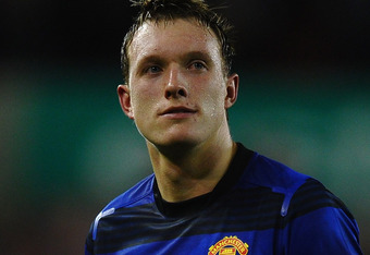 STOKE ON TRENT, ENGLAND - SEPTEMBER 24:  Dejected Phil Jones of Manchester United after a draw in the Barclays Premier League match between Stoke City and Manchester United at the Britannia Stadium on September 24, 2011 in Stoke on Trent, England.  (Photo