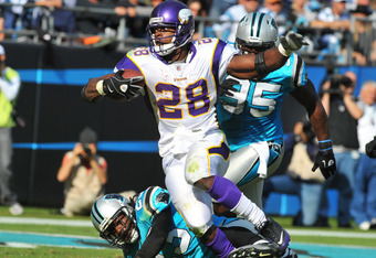 CHARLOTTE, NC - OCTOBER 30:  Running back Adrian Peterson #28 of the Minnesota Vikings runs for a nine yard touchdown in the third quarter against the Carolina Panthers October 30, 2011 at Bank of America Stadium in Charlotte, North Carolina.  The Vikings