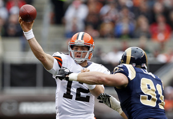 CLEVELAND, OH - NOVEMBER 13:  Quarterback Colt McCoy #12 of the Cleveland Browns throws to a receiver over defensive end Chris Long #91 of the St. Louis Rams at Cleveland Browns Stadium on November 13, 2011 in Cleveland, Ohio.  (Photo by Matt Sullivan/Get