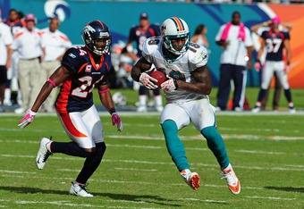 MIAMI GARDENS, FL - OCTOBER 23: Brandon Marshall #19 of the Miami Dolphins runs with a catch against Champ Bailey #24 of the Denver Broncos at Sun Life Stadium on October 23, 2011 in Miami Gardens, Florida. (Photo by Scott Cunningham/Getty Images)