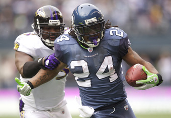 SEATTLE, WA - NOVEMBER 13:  Running back Marshawn Lynch #24 of the Seattle Seahawks rushes the ball as linebacker Jameel McClain #53 of the Baltimore Ravens pursues. at CenturyLink Field on November 13, 2011 in Seattle, Washington. The run set up a one ya
