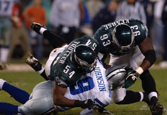 Philadelphia Eagles linebacker Jeremiah Trotter (54) and defensive end Jevon Kearse (93)  stop the Dallas Cowboys  wide receiver Keyshawn Johnson November 14, 2005 at Lincoln Financial Field in Philadelphia. The Cowboys defeated the Eagles 21 - 20.  (Phot