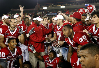 HOUSTON - OCTOBER 27:  Quarterback Case Keeum #7 receives the  game ball from coach Kevi Sumlin after defeating the Rice Owls 73-34 to regain the 'Bayou Bucket' at Robertson Stadium on October 27, 2011 in Houston, Texas.  (Photo by Bob Levey/Getty Images)