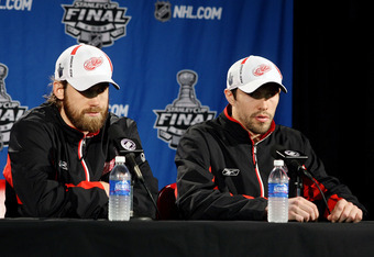 DETROIT - JUNE 06:  Henrik Zetterberg #40 and Pavel Datsyuk #13 of the Detroit Red Wings speak to the media during a press conference after winning Game Five of the 2009 NHL Stanley Cup Finals at Joe Louis Arena on June 6, 2009 in Detroit, Michigan.  (Pho