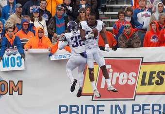 BOISE, ID - NOVEMBER 12:  Waymon James #32 and Josh Boyce #82 of the TCU Horned Frogs celebrate a touchdown against the Boise State Broncos at Bronco Stadium on November 12, 2011 in Boise, Idaho.  (Photo by Otto Kitsinger III/Getty Images)
