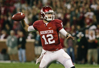 NORMAN, OK - OCTOBER 22:  Quarterback Landry Jones #12 of the Oklahoma Sooners looks to throw in the first half against theTexas Tech Red Raiders on at Gaylord Family-Oklahoma Memorial Stadium on October 22, 2011 in Norman, Oklahoma.  Oklahoma was upset b