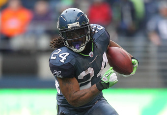 SEATTLE - NOVEMBER 13:  Running back Marshawn Lynch #24 of the Seattle Seahawks rushes against the Baltimore Ravens at CenturyLink Field on November 13, 2011 in Seattle, Washington. (Photo by Otto Greule Jr/Getty Images)