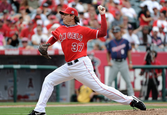 ANAHEIM, CA - SEPTEMBER 04:  Scott Downs #37 of the Los Angeles Angels of Anaheim pitches against the Minnesota Twins at Angel Stadium of Anaheim on September 4, 2011 in Anaheim, California.  (Photo by Harry How/Getty Images)