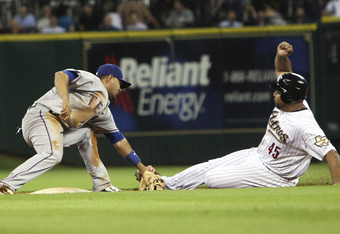 HOUSTON - JUNE 29:  Carlos Lee #45 of the Houston Astros is tagged out attempting to steal second base by shortstop Andres Blanco #3 of the Texas Rangers to end the game at Minute Maid Park on June 29, 2011 in Houston, Texas.  (Photo by Bob Levey/Getty Im