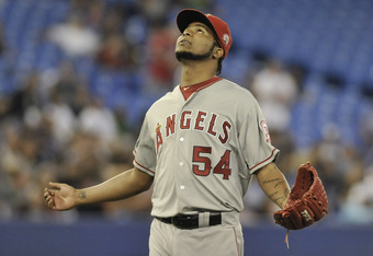 TORONTO, CANADA - SEPTEMBER 22:  Ervin Santana #54 of the Los Angeles Angels of Anaheim looks skyward after being pulled from the game during MLB action September 22, 2011 at Rogers Centre in Toronto, Ontario, Canada. (Photo by Brad White/Getty Images)
