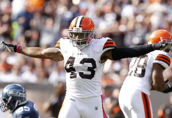 CLEVELAND, OH - OCTOBER 23:  Defensive back T.J. Ward #43 of the Cleveland Browns celebrates after an interception against the Seattle Seahawks at Cleveland Browns Stadium on October 23, 2011 in Cleveland, Ohio.  (Photo by Matt Sullivan/Getty Images)