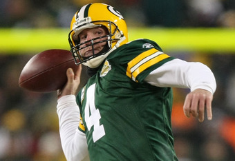 GREEN BAY, WI - JANUARY 20:  Quarterback Brett Favre #4 of the Green Bay Packers throws the ball during the second half of the NFC championship game against the New York Giants on January 20, 2008 at Lambeau Field in Green Bay, Wisconsin.  (Photo by Jed J
