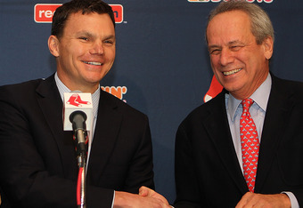 BOSTON, MA - OCTOBER 25:  Ben Cherington shakes his hands with Larry Lucchino after Cherington was named the Executive Vice President/ General manager of the Boston Red Sox at Fenway Park October 25, 2011 in Boston, Massachusetts. Lucchino is the Presiden