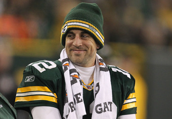 GREEN BAY, WI - NOVEMBER 14: Aaron Rodgers #12 of the Green Bay Packers smiles at a teammate on the sidelines in the 4th quarter against the Minnesota Vikings at Lambeau Field on November 14, 2011 in Green Bay, Wisconsin. The Packers defeated the Vikings