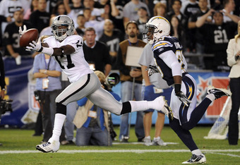 SAN DIEGO, CA - NOVEMBER 10:   Denarius Moore #17 of the Oakland Raiders makes a catch for 47 yards in front of Quentin Jammer #23 of the San Diego Chargers at Qualcomm Stadium on November 10, 2011 in San Diego, California.  (Photo by Harry How/Getty Imag