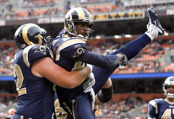 CLEVELAND, OH - NOVEMBER 13:  Wide receiver Brandon Lloyd #83 of the St. Louis Rams celebrates after scoring a touchdown with Harvey Dahl #62 against the Cleveland Browns at Cleveland Browns Stadium on November 13, 2011 in Cleveland, Ohio.  (Photo by Matt