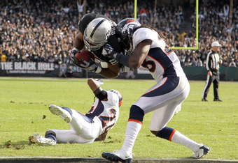 OAKLAND, CA - NOVEMBER 06:  Michael Bush #29 of the Oakland Raiders dives in for a touchdown against the Denver Broncos at O.co Coliseum on November 6, 2011 in Oakland, California.  (Photo by Ezra Shaw/Getty Images)