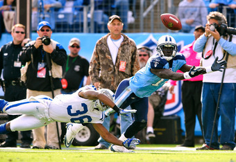 NASHVILLE, TN - OCTOBER 30:  Damian Williams #17 of the Tennessee Titans can't make the diving catch in the end zone as Chris Rucker #36 of the Indianapolis Colts defends during play at LP Field on October 30, 2011 in Nashville, Tennessee. The Titans won