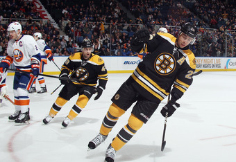UNIONDALE, NY - NOVEMBER 19:  Chris Kelly #23 of the Boston Bruins celebrates his goal against the New York Islanders at 18:45 of the first period at the Nassau Veterans Memorial Coliseum on November 19, 2011 in Uniondale, New York.  (Photo by Bruce Benne