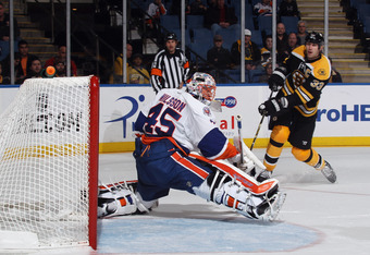 UNIONDALE, NY - NOVEMBER 19: Zdeno Chara #33 of the Boston Bruins scores a third period goal against Anders Nilsson #45 of the New York Islanders at the Nassau Veterans Memorial Coliseum on November 19, 2011 in Uniondale, New York. The Bruins defeated the