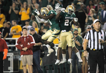 WACO, TX - NOVEMBER 19: Terrance Ganaway #24 of the Baylor Bears celebrates with teammates after a touchdown during a game against the Oklahoma Sooners at Floyd Casey Stadium on November 19, 2011 in Waco, Texas. The Baylor Bears defeated the Oklahoma Soon