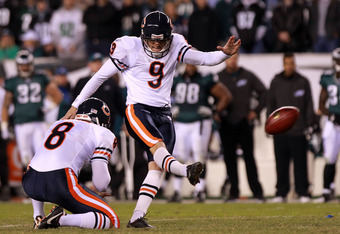 PHILADELPHIA, PA - NOVEMBER 07: Placekicker Robbie Gould #9 of the Chicago Bears kicks for an extra point alongside teammate  Adam Podlesh #8 during the fourth quarter of the game against the Philadelphia Eagles at Lincoln Financial Field on November 7, 2