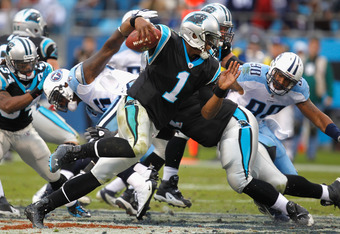CHARLOTTE, NC - NOVEMBER 13:  Cam Newton #1 of the Carolina Panthers runs with the ball during their game against the Tennessee Titans at Bank of America Stadium on November 13, 2011 in Charlotte, North Carolina.  (Photo by Streeter Lecka/Getty Images)