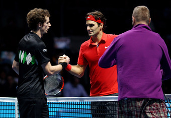 LONDON, ENGLAND - NOVEMBER 23:  Roger Federer (R) of Switzerland shakes hands with Andy Murray of Great Britain after winning his men's singles match during the ATP World Tour Finals at O2 Arena on November 23, 2010 in London, England.  (Photo by Julian F