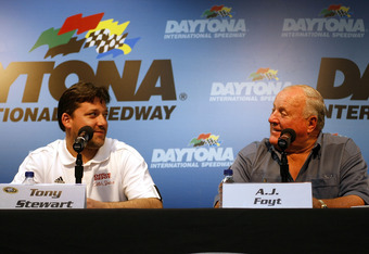 DAYTONA BEACH, FL - FEBRUARY 13:  Tony Stewart, driver of the #14 Office Depot/Old Spice Chevrolet (L) jokes with racing legend A.J. Foyt (R) during a press conference prior to practice for the NASCAR Sprint Cup Series Daytona 500 at Daytona International
