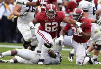 TUSCALOOSA, AL - NOVEMBER 19:  Defensive lineman Brandon Ivory #62 of the Alabama Crimson Tide celebrates after a tackle during the game against the Georgia Southern Eagles at Bryant-Denny Stadium on November 19, 2011 in Tuscaloosa, Alabama.  (Photo by Mi