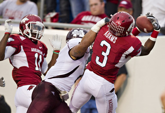 LITTLE ROCK, AR - NOVEMBER 19:   Joe Adams #3 of the Arkansas Razorbacks catches a touchdown pass against the Mississippi State Bulldogs at War Memorial Stadium on November 19, 2011 in Little Rock, Arkansas. The Razorbacks defeated the Bulldogs 44-17.  (P