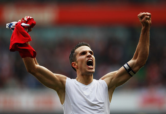 LONDON, ENGLAND - OCTOBER 16:  Robin van Persie of Arsenal celebrates as he scores their second goal during the Barclays Premier League match between Arsenal and Sunderland at the Emirates Stadium on October 16, 2011 in London, England.  (Photo by Paul Gi