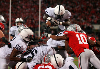 COLUMBUS, OH - NOVEMBER 19:  Silas Redd #25 of the Penn State Nittany Lions is stopped short of the goal line by the defense of the Ohio State Buckeyes during the third quarter on November 19, 2011 at Ohio Stadium in Columbus, Ohio. Penn State defeated Oh