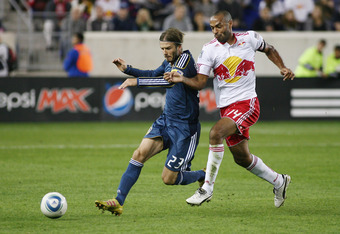 HARRISON, NJ - OCTOBER 04: David Beckham #23 of the Los Angeles Galaxy and Thierry Henry #14 of the New York Red Bulls battle hard for a loose ball during the game at Red Bull Arena on October 4, 2011 in Harrison, New Jersey. (Photo by Andy Marlin/Getty I