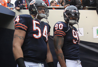 CHICAGO, IL - NOVEMBER 20: Brian Urlacher #54 and Julius Peppers #90 of the Chicago Bears await player introductions before a game against the San Diego Chargers at Soldier Field on November 20, 2011 in Chicago, Illinois. The Bears defeated the Chargers 3