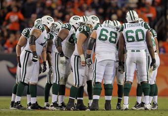 DENVER, CO - NOVEMBER 17:  The New York Jets offense huddles up against the Denver Broncos at Sports Authority Field at Mile High on November 17, 2011 in Denver, Colorado. The Broncos defeated the Jets 17-13.  (Photo by Doug Pensinger/Getty Images)