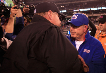 EAST RUTHERFORD, NJ - NOVEMBER 20:  Head coach Andy Reid of the Philadelphia Eagles is congratulated by head coach Tom Coughlin of the New York Giants after the Eagles won 17-10 at MetLife Stadium on November 20, 2011 in East Rutherford, New Jersey.  (Pho