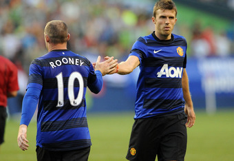 SEATTLE, WA - JULY 20: Wayne Rooney #10 of Manchester United celebrates with teammate Michael Carrick #16 after scoring a goal during the second half of the game against the Seattle Sounders FC at CenturyLink Field on July 20, 2011 in Seattle, Washington.