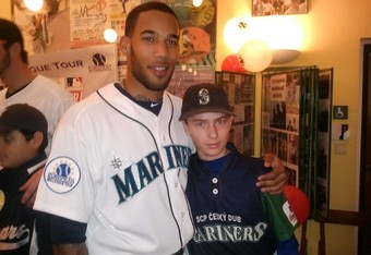 Halman with a young baseball player at one of his Europe camps.