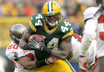 GREEN BAY, WI - NOVEMBER 20:  James Starks #44 of the Green Bay Packers carries the ball against the Tampa Bay Buccaneers at Lambeau Field on November 20, 2011 in Green Bay, Wisconsin.  (Photo by Matthew Stockman/Getty Images)