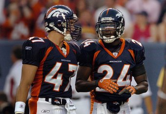 DENVER - AUGUST 25:  Safety John Lynch #47 and Champ Bailey #24 of the Denver Broncos talk during the pre-season football game against the Cleveland Browns on August 25, 2006 at Invesco Field at Mile High in Denver, Colorado.     (Photo by Steve Dykes/Get