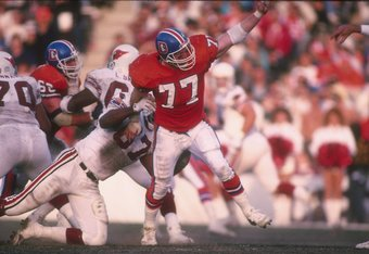 16 Dec 1989: Defensive lineman Karl Mecklenburg of the Denver Broncos gets blocked by a Phoenix Cardinals player during a game at Mile High Stadium in Denver, Colorado. The Broncos won the game, 37-0.