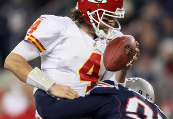 FOXBORO, MA - NOVEMBER 21:  Tyler Palko #4 of the Kansas City Chiefs is sacked by Mark Anderson #95 of the New England Patriots on November 21, 2011 at Gillette Stadium in Foxboro, Massachusetts.  (Photo by Elsa/Getty Images)